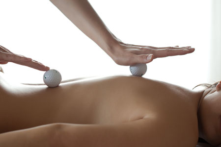 Relax after a round with Golf ball massage
