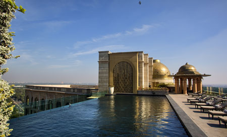 Inspiring. Roof top swimming pool with views over New Delhi at Leela Palace