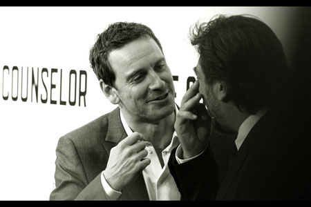 Michael Fassbender and Javier Bardem deep in conversation