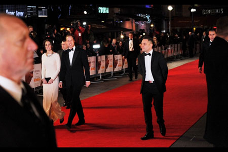 Prince William and The Duchess of Cambridge (Hitchcock lookalike in foreground) at Mandela premiere