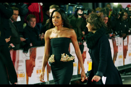 Fashionable Naomie Harris, 'with wings' at Mandela Premiere