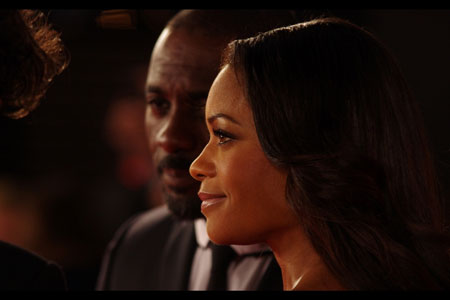 Up close, Naomi Harris and Idris Elba