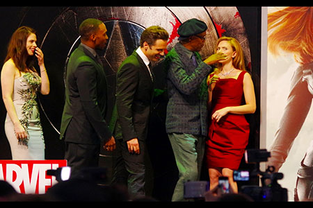 Anthony Mackie, Sebastian Stan as Samuel L Jackson wipes Scarlett Johansson's nose