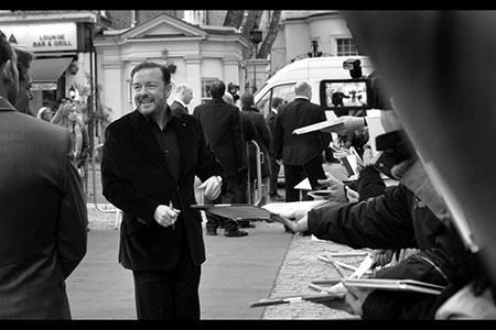 Ricky Gervais signs for fans