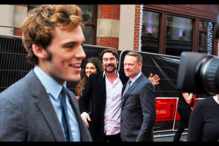 Sam Claflin with Jared Harris floating in the background