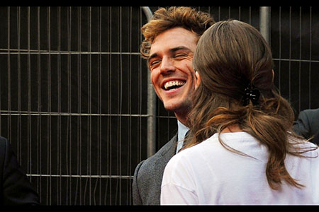 Sam Claflin enjoys a joke with actress wife Laura Haddock