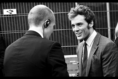 Sam Claflin with security