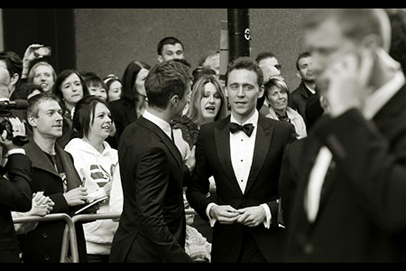 Tom Hiddleston in deep conversation