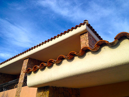 Typical Sardinian red slate architecture and blue sky
